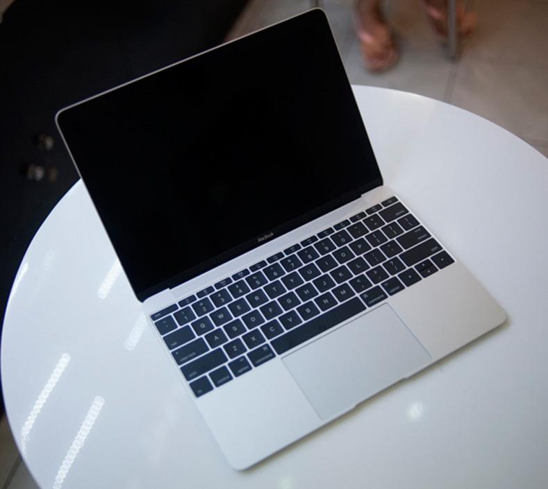 12-дюймовый MacBook против портативных компьютеров Windows